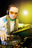 Dj woman playing music by mixer Stock Photo