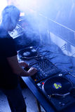 Dj at work. In a disco Royalty Free Stock Images