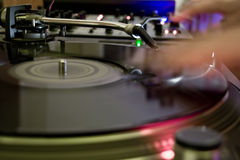 DJ at work. DJ is mixing the turntables Stock Photography