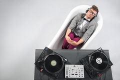 Dj at work in bath isolated on white background Royalty Free Stock Images