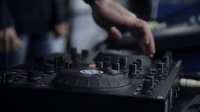 DJ work. Hands of a DJ on the mixer stock video