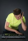 Dj at work isolated on dark grey background Royalty Free Stock Photos