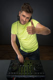 Dj at work isolated on dark grey background Royalty Free Stock Photo