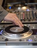 DJ working his console Royalty Free Stock Photography