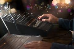 DJ working at radio broadcasting studio. Royalty Free Stock Image