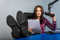 Dj working on the radio. Female dj working in front of a microphone on the radio Stock Photo
