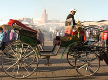 Djeema El Fna in Marrakech, Morocco. Cart or caleche in traditional style in a scenic view of Djemma El Fna in Marrakech or Marrakesh, Morocco. Popular busy stock photos