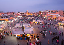 Djeema El Fna night market, Marrakech. View of a traditional and busy night market stalls in Djeema El Fna. A famous destination for tourism and a unique place royalty free stock image
