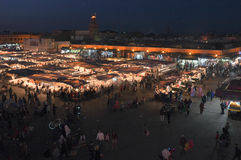 Djeema El Fna at night, Marrakech. View of a traditional and busy night market stalls in Djeema El Fna in Marrakesh - Marrakech, Morocco. A famous destination royalty free stock photography