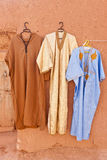 Djellaba - traditional outer robe. Djellaba Garments Hanging on a Wall, North Africa Royalty Free Stock Image