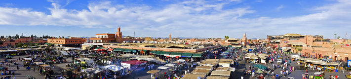 Djemaa el Fna market in Marrakesh, Morocco. With Koutubia Mosque at the back stock images