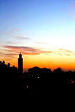 Djemaa El-fna moské, Marakesh, Morroco på skymning Julian Bound Royaltyfri Foto