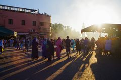 Djemaa el Fna square. Also known as Sleepless Square , a very famous market in Marrakesh , tourists and locals on the Djemaa-el-Fna square , Morocco royalty free stock photo