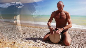Djembe Drum Player beat rythm on the lonely beach