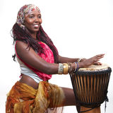 Djembe Drummer. A woman of african descent plays the Djembe drum, isolated on white Royalty Free Stock Photo