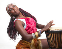Djembe Drummer. An African American woman plays the djembe drum Royalty Free Stock Photos