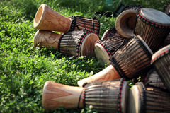 Djembe drums on  grass. Djembe drums on green grass Royalty Free Stock Image