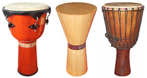 Djembe drums. Three wooden jembe drums isolated on white background Stock Photo