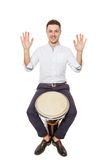 Djembe between the legs Royalty Free Stock Photo