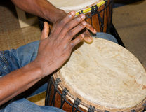 Djembe player. African djembe drummer - african drum with leather membrane and wooden body Royalty Free Stock Images