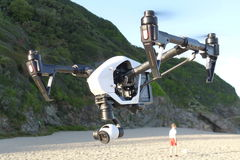 DJI Inspire 1 Drone. A DJI Inspire 1 Drone doing a survey along the coastline stock photography