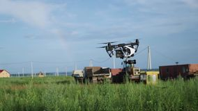 DJI Inspire 1 PRO drone flyes near ground`s surface. On Construction Site stock footage