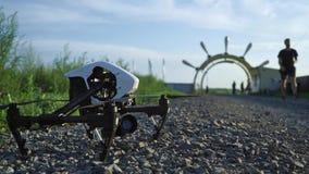 DJI Inspire 1 PRO landing on ground. DJI Inspire 1 PRO landing on gravel ground stock video footage