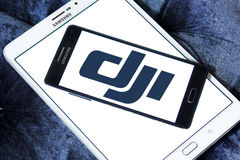 Dji logo. Logo of dji company on samsung mobile on samsung tablet. DJI is the leading company in the civilian drone industry Royalty Free Stock Photography