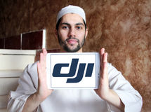 Dji logo. Logo of dji company on samsung tablet holded by arab muslim man. DJI is the leading company in the civilian drone industry Stock Photography
