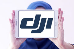 Dji logo. Logo of dji company on samsung tablet holded by arab muslim woman. DJI is the leading company in the civilian drone industry Royalty Free Stock Photos