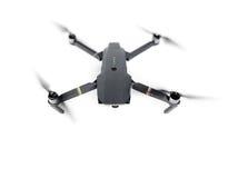 DJI Mavic Pro drone in flight, on white background. stock photo