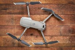 DJI Mavic 2 pro drone with Hasselblad camera. Fort Collins, CO, USA - December 27, 2018: DJI Mavic 2 pro against rustic wood - an andvanced prosumer folding royalty free stock images