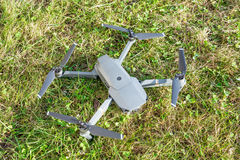 DJI Mavic Pro drone: Latvia JANUARY 25, 2017. Closeup on green grass background. Royalty Free Stock Photos