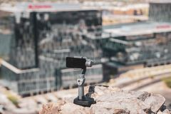 DJI Osmo Mobile 2 in use. Tempe,Az,USA-5.2.18: DJI Osmo Mobile 2. DJI is a Chinese technology company. DJI revealed a new version of its popular gimbal at a much stock photography