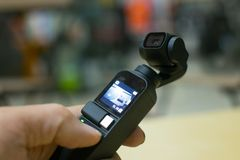 DJI OSMO POCKET. The small camera combine with gimbal can take VDO 4K 60fps and have many feature for photography and footage royalty free stock photo
