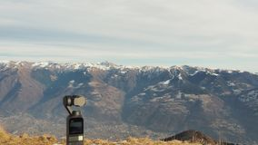 Dji Osmo pocket gimbal. Alps mountain range in the background. Electronic object stock video footage
