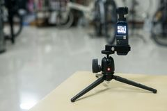 DJI Osmo Pocket the small camera combine with gimbal can take VDO 4K 60fps and have many feature for photography and footage. The DJI Osmo Pocket the small royalty free stock photography