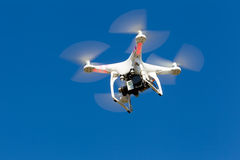 DJI Phantom drone in flight with a mounted GoPro Hero3+ Black Ed Royalty Free Stock Photos