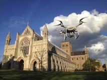 A DJI Phantom 4 drone takes flight to capture views of the Abbey. ST ALBANS, UK - APRIL 29, 2016: A DJI Phantom 4 drone takes flight to capture views of the stock photo