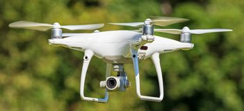 DJI Phantom 4 Pro drone in flight Stock Images