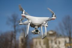 Dji phantom4 pro, the quadcopter hovering in the air. Dji phantom4 pro quadcopter hovering in the air, with rotating propellers. Aircraft. Video camera in the Royalty Free Stock Photo