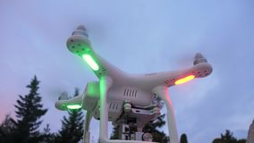 DJI Phantom 4 Pro, Quadcopter taking off from the ground. Slow motion footage of DJI Phantom 4 Pro, drone flashing lights and taking off from the ground in early stock video