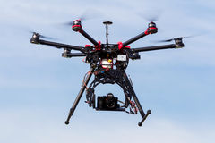DJI S900 drone in flight with a mounted sony A7 Edition digital. ATHENS, GREECE- DECEMBER 20, 2014: DJI S900 drone in flight with a mounted sony A7 Edition royalty free stock image