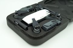 DJI Spark Alpine White drone quadcopter and battery`s in a carrying case. Amsterdam, The Netherlands- December 17, 2017: op view of DJI Spark Alpine White drone stock images