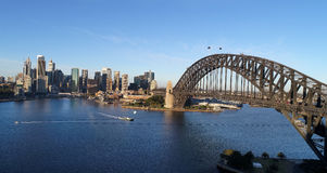 DJI Sy CBD Kirrib Bridge Arch 2 Rocks. Aerial wide view across Sydney Harbour above arch of the Harbour Bridge towards the Rocks , Circular Quay and CBD high Royalty Free Stock Image