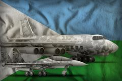 Djibouti air forces concept on the state flag background. 3d Illustration. Air forces with grey camouflage on the Djibouti flag background. Djibouti air forces royalty free illustration