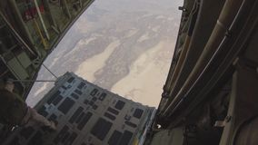 DJIBOUTI, AUGUST 2013, US Marines Parachute. US Marines at a parachute drop out of a KC-130J Super Hercules aircraft stock video