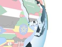 Djibouti avec le drapeau sur le globe illustration libre de droits