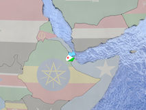 Djibouti avec le drapeau sur le globe Photos stock