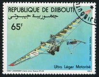 Motorized Hang Gliders. DJIBOUTI - CIRCA 1984: stamp printed by Djibouti, shows Motorized Hang Gliders, circa 1984 royalty free stock photo